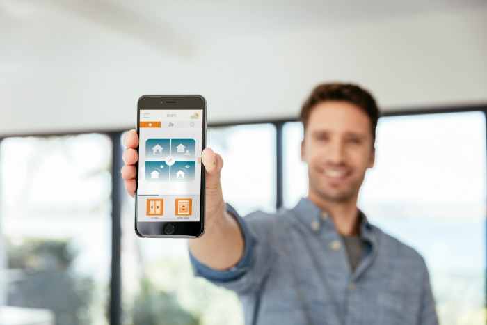 Home Automation app on smart phone with Somfy logo