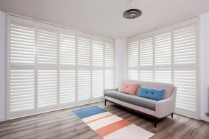 Fiji shutters in Winchester White finish in living room window installation