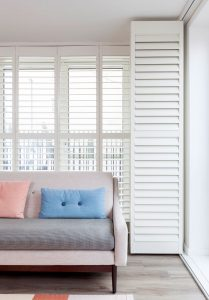 Winchester White Shutters opened in living room with contemporary living room.