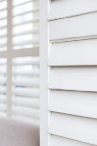 Fiji shutters panel with slats closed in Winchester White colour