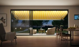 LED lighting on awning at night over patio doors.