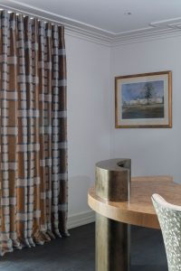 Designer curtains with lined fabric design in contemporary study area.