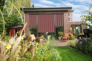 Markilux vertical awnings on large windows.
