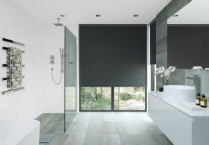 Roller blind with charcoal colour fabric in bathroom window.