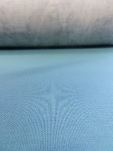 curtain and blind fabric sample in sky blue colour.