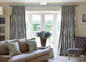 Acrylic curtain poles and curtains with Seychelles pattern in living room French door window.
