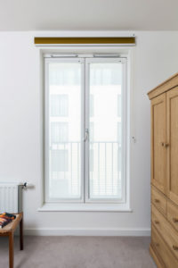 Luxaflex® Duette® Shades fully closed sitting above bedroom window.