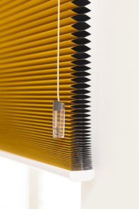 Duette® blind with compressed honeycomb slats and SmartCord control.