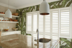 White security shutters in contemporary kitchen window.