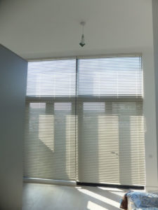 Metal Venetian Blinds open in large bedroom window at Bath Riverside.