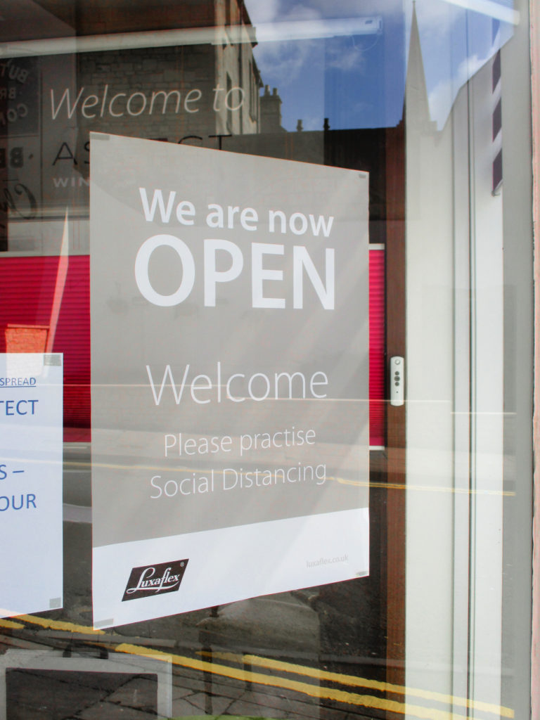 social distancing Luxaflex poster on Aspect window styling showroom window