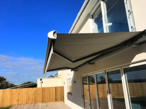 Markilux 990 awning extended over large decking area.