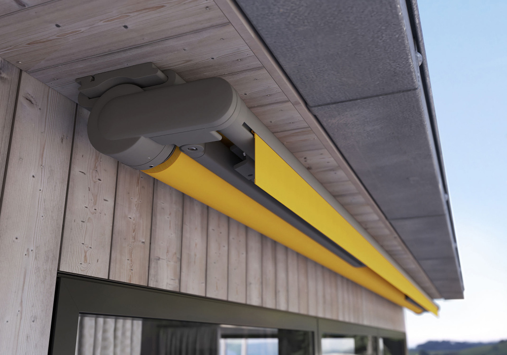 The 930 awning fully retracted under balcony eave.