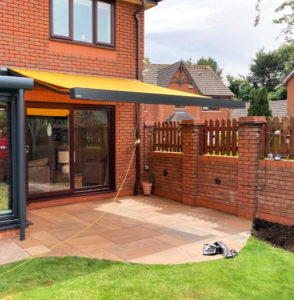 Markliux 970 awning extended over patio.