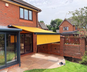 Markilux 970 electric awning with shade plus extended over patio.