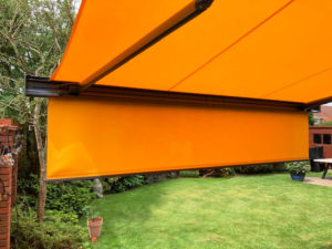 Markilux 970 awning model with shadeplus cover extended over garden.
