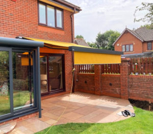Markilux 970 awning extended over garden patio