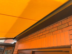 Markilux 970 awning extended over garden and patio area