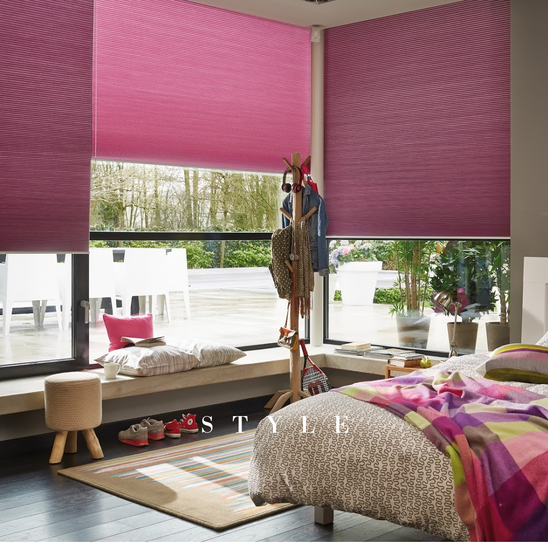 Duette blinds with fuchsia pink blackout fabric in children's bedroom window.