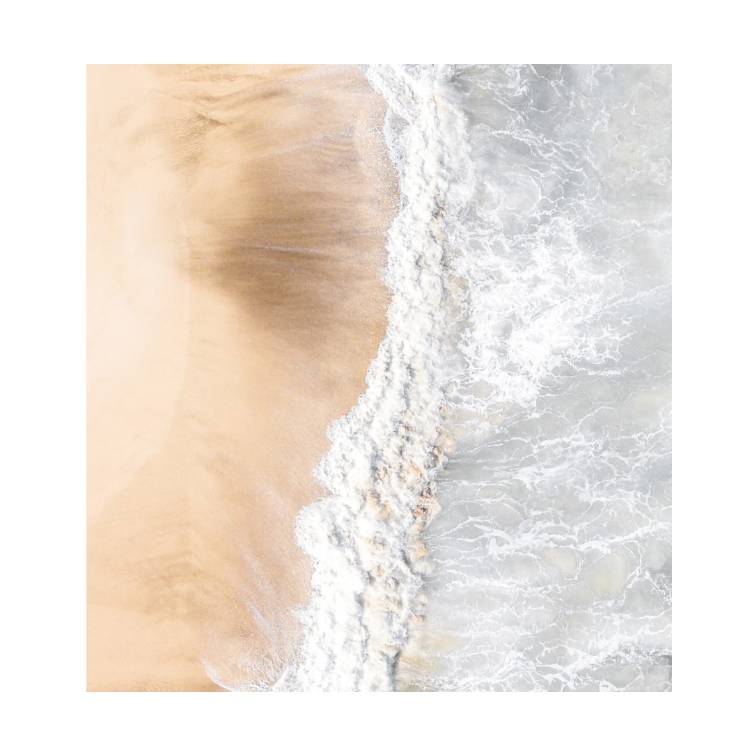 Clean coean waves breaking on shores.
