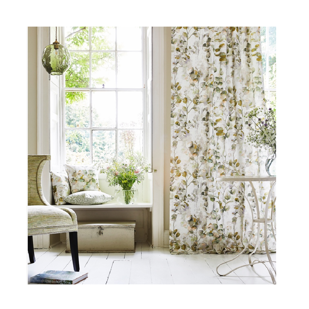 Floral prints curtain fabric in traditional living room space.