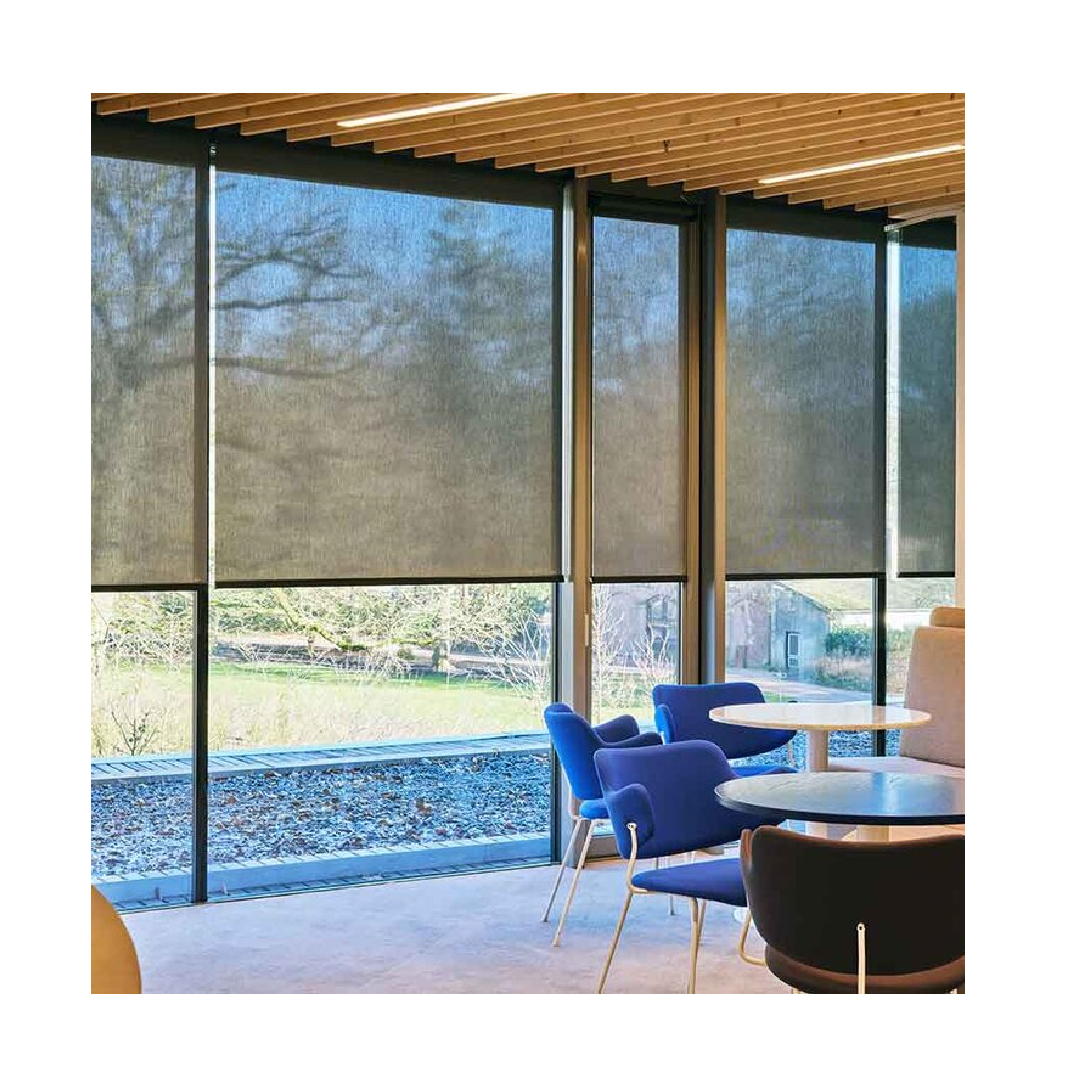 Greenscreen Sea tex recycled roller blinds with translucent fabric in large glass window