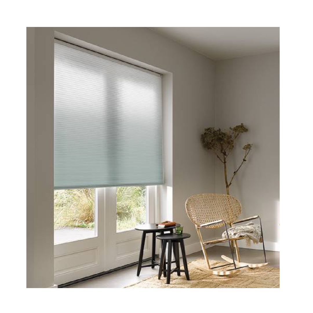 Ombre blinds with light blue gradient neutral living room