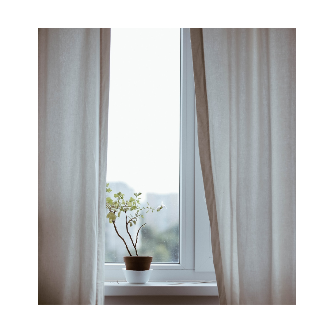 curtains open over light window sil