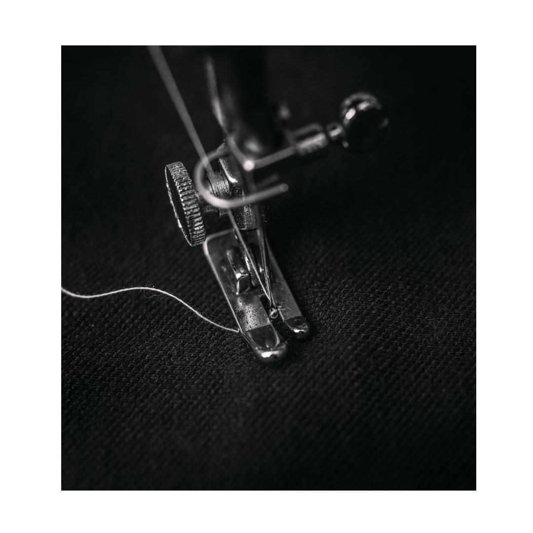 Machine sewn curtains process close up of mechanism