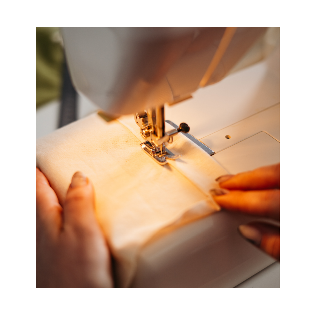 sewing machine sewing seams on curtain fabric