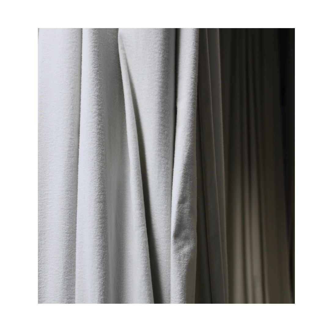 Curtains in light grey finish with light and shadow gradient.